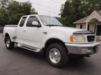 Options Included: Tonneau Cover, Running Boards, 4
