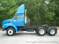 This 1998 Ford LT9513 TANDEM TRACTOR 3306 CAT JAKE
