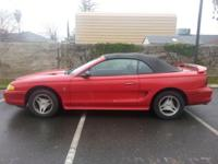 Red mustang with black top. Exceptional condition. Do