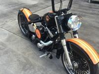 The motor and tranny are 100% original Harley-Davidson.