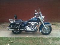 THIS IS A NICE LOW MILAGE HARLEY DAVIDSON ROAD KING. IT