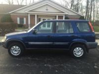 The 1998 Honda CR-V is a compact SUV that seats 5