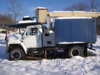 1998 International 4900. Blue international 55' boom