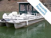 This 1998 JC 24 Suntoon Tritoon brings efficiency and