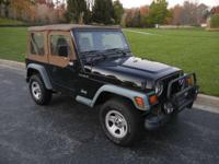 Options Included: Convertible Soft Top, Steel Wheels,