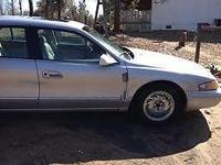 98 -4 door Silver w- grey leather interior, heated