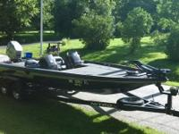 This is a 21 foot 1998 Nitro Savage 912 Bass Boat that