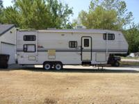 One slide, awning, rear bunks, electric/gas fridge, gas