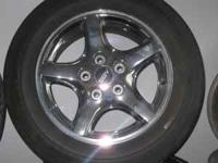We have a factory set of wheels for a 1998 Pontiac