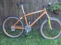 For sale is an orange Spooky Junebug XT. The bike is in