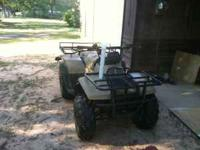 1998 Suzuki four wheeler 4x4. smokes but runs good.