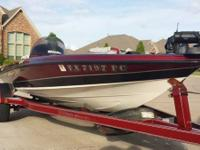 this is a 1998 Triton bass boat TR17 series with a 90