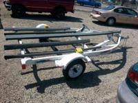 For Sale is a 1998 Yaht Club Trailer, 2 place jet ski,