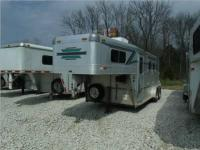 THIS TRAILER IS A 1999 2 HORSE SLANT LOAD 4 STAR WITH A