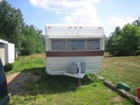 19 foot apache camper sleeps 4. Bathroom stove