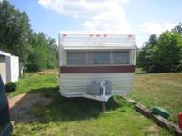 19 foot apache camper sleeps 4. Bathroom stove