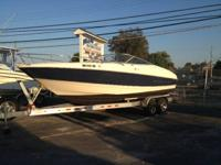 This 1999 Bayliner 2352 LS Cuddy cabin is powered by a