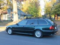 This is a really nice Dark Green 540i Wagon at a