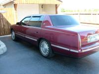 A beautiful maroon 4 door Deville Cadillac,32 valve