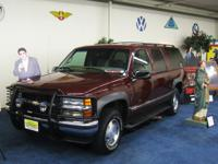 This burgundy 1999 Chevrolet Suburban was the actual