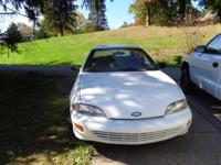 THIS 1999 CHEVY CAVALIER SEDAN IN WHITE HAS GREY CLOTH