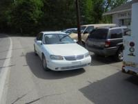 THIS 1999 CHEVY MALIBU SEDAN IN WHITE HAS GREY CLOTH