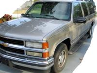 For Sale is a Loaded 1999 Chevrolet Suburban LT. Pewter