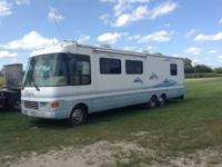 1999 Dolphin motor coach. Has slide for expanded living