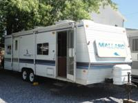 1999 Fleetwood Mallard 27'. Full bedroom in rear, table