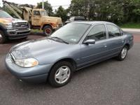 This 1999 Ford Contour LX Sedan is in good condition