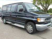 This 1999 Ford E-150 conversion van is ready to go on a