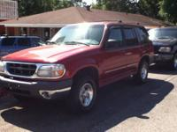 Red 1999 Ford Explorer with 130k miles on it and in top