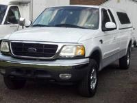 This is a 1999 Ford F-150 Extended Cab XLT 4x4 8 ft.