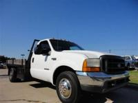 THIS 1999 FORD F350 FLATBED JUST CAME IN. THIS FORD