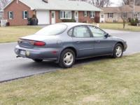 Blue 1999 Ford Taurus 24 Valve DOHC in good condition.