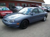 1999 Ford Taurus Se Sedan. 6 Cyndrical tube 3.0 L.