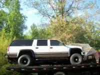 This a GMC 4x4 Suburban Parts Truck. The entire left