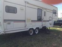 1999 Golden Falcon Camper 29ft double sides sleeps 6 ,