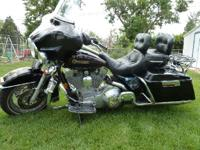 1999 Harley Davidson FLHT Electra Glide. Equipped with