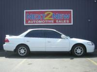 Options Included: This White 1999 Honda Accord LX Comes