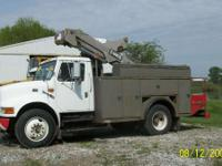 1999 International 4700 buck truck with 40ft reach