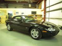 This 1999 Jaguar XK8 Convertible is a glamorous,