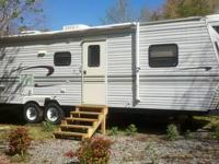 1999 Jayco 31' slide out camper. Good condition.