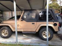 Tan with a Black soft top. New tires, transmission and