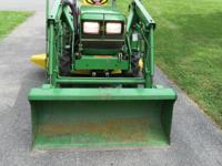 This is a John Deere 4x4 4100 Compact tractor w/ loader