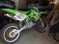 1999 Kawasaki KX 100 2 stroke with paddle, FMF pipe.