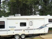 1999 KEYSTONE MONTANA(2 SLIDES) AND 1 LARGE AWNING ONE