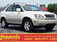 Clean CARFAX. This 1999 Lexus RX 300 in Golden Pearl/CK