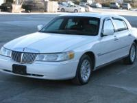 The Vehicle..........1999 Lincoln Town Car in white