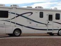 1999 National RV Tradewinds White Exterior Multi Color